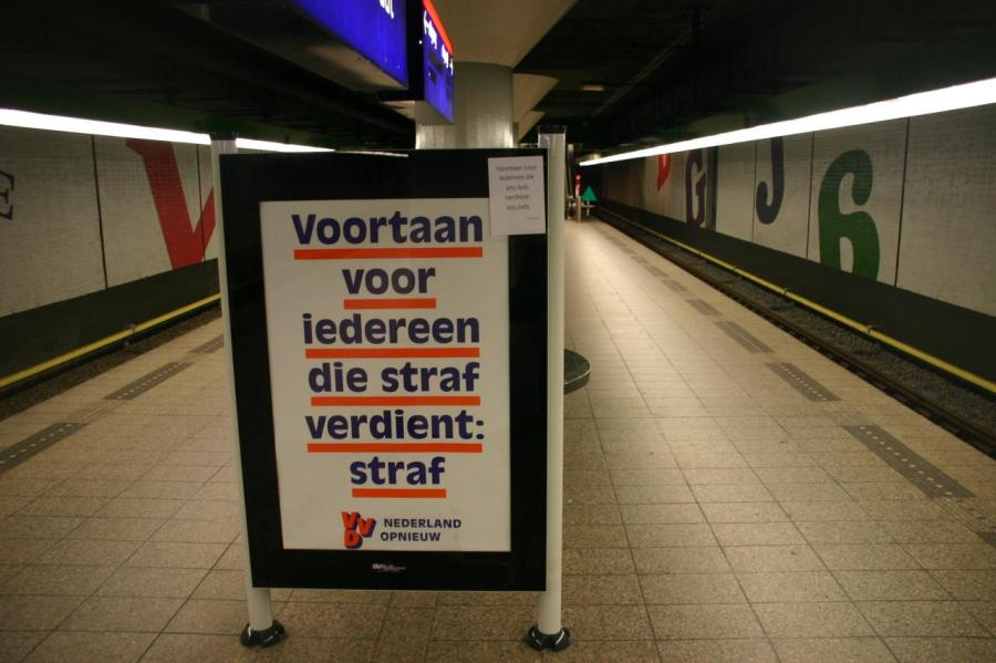 """Liberal Party poster in Amsterdam subwat station Wibautsraat with in the right corner a A4 leaflet stuck with a piece of tape """"From now on for / everyone that deserves something lovely: / something lovely (liefs in Dutch can also be translated as 'sweet' or 'dear')"""