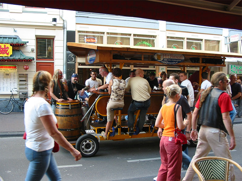 An example of a what is called a Fietscafé (Bicycle Cafe) in the inner town of Amsterdam; one can hear them coming, passing and disappearing on a long distance as bouts of drunken shouts accompany the pedalling exercise