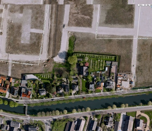 "A firm layer of sand is sprayed over the old landscape to create a tabula rasa for the mortgage architecture.. curious is the fact that the road next to the canal is called ""sand road"" (zandweg)."